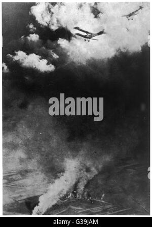 A dogfight between Russian and  German aircraft. One of the  earliest pictures of air  warfare.        Date: 1914 - Stock Photo