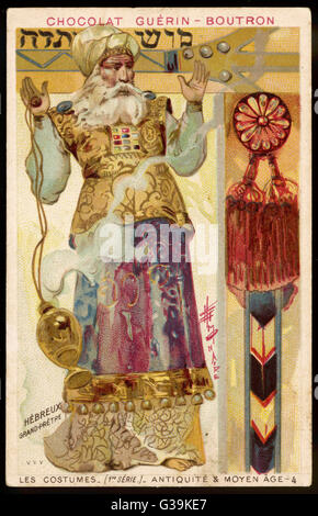 A Hebrew High Priest in ornate  gold and red robes, praying  with raised hands and swinging a smoking censer    - Stock Photo