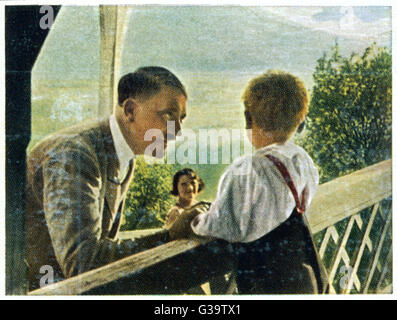 ADOLF HITLER  Relaxing with some young  friends at Berchtesgaden, circa 1933      Date: 1889 - 1945 - Stock Photo
