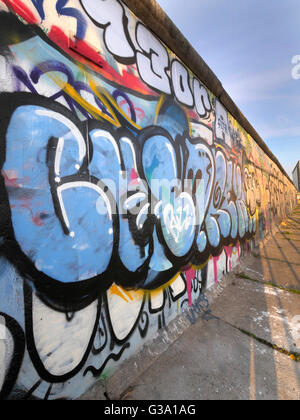 Part of the 'East Side Gallery', piece of the Berlin Wall painted after the Fall of the Berlin Wall, Berlin, Germany, - Stock Photo
