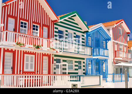 Portugal: Colorful charming cottage houses 'Palheiros da Costa Nova' - Stock Photo
