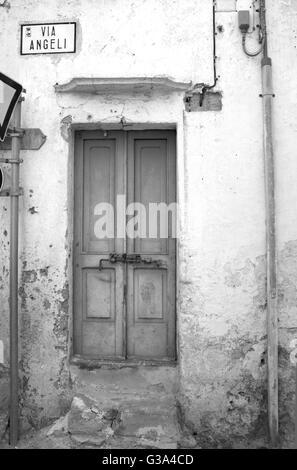 old locked door outdoor on the street level - Stock Photo