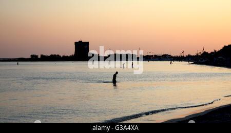 Bath in the sea at dusk puglia, italy - Stock Photo