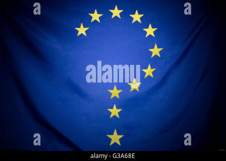 A large EU flag edited into the shape of a question mark, symbolizing a decision or choice concerning Europe. - Stock Photo