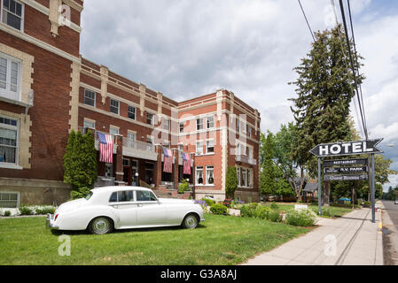 Rolls-Royce in front of the Union Hotel in Union, Oregon. - Stock Photo