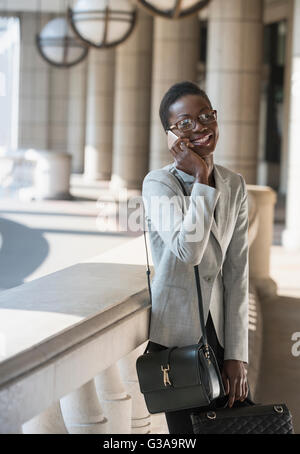 Portrait smiling corporate businesswoman talking on cell phone - Stock Photo