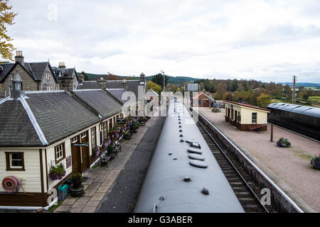 Looking down from footbridge to Boat of Garten Railway Station and along the Strathspey Railway in Scottish Highlands - Stock Photo