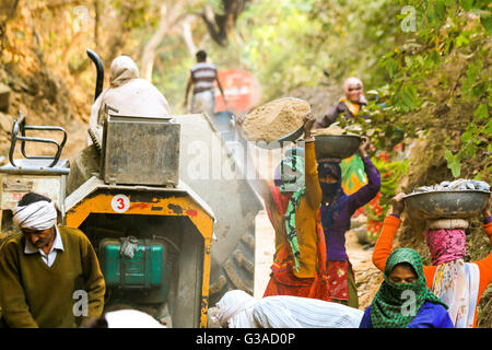 Untouchable Indian men and women digging road  at Ranthambore Fort, India - Stock Photo
