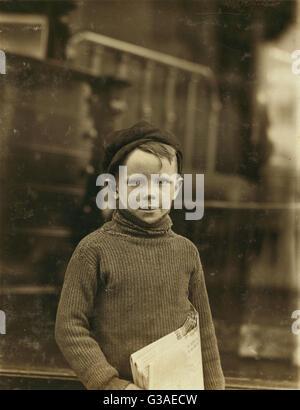 Boy named Gurley. An eight year old newsie. 18th & Washington Sts.  Location: St. Louis, Missouri. Date 1910 - Stock Photo
