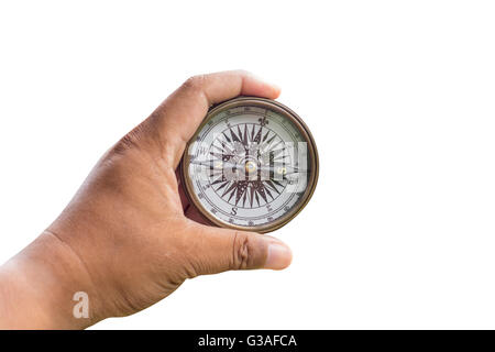 Compass on man hand on isolated with clipping path. - Stock Photo