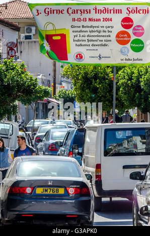 Traffic driving along a street in the city of Kyrenia in Northern Cyrpus. - Stock Photo