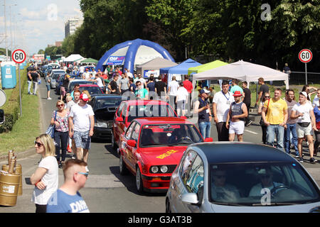 People sightseeing lined up cars waiting for the race at Fast and furious street race at Avenue Dubrovnik in Zagreb, - Stock Photo