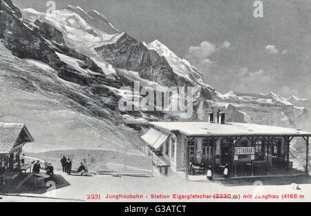 Jungfrau with Eigergletscher (Eiger Glacier) station, Switzerland.      Date: circa 1910 - Stock Photo