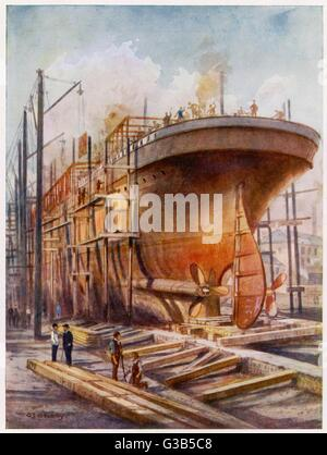 A ship on the stocks in a  British shipyard during World  War One, when ships were being  built as rapidly as possible - Stock Photo
