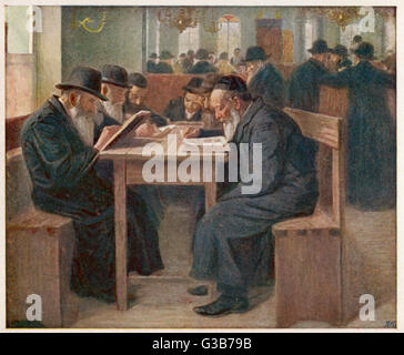 Jews studying the Talmud, a  compilation of ancient Jewish  law and tradition : probably  in the Netherlands.   - Stock Photo