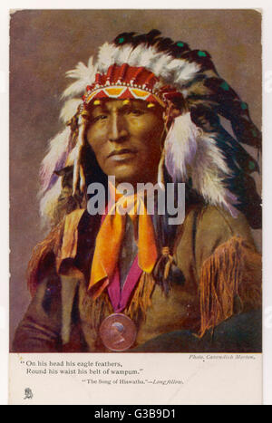 Iroquois chief wearing  a feathered headdress,  illustrating Longfellow's Song of Hiawatha      Date: 1904 - Stock Photo