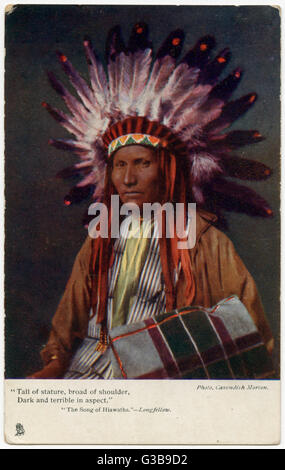 Elderly Iroquois chief wearing a feathered headdress and  carrying a blanket over his  arm, to illustrate  Longfellow's - Stock Photo