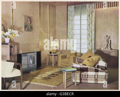 A living room decorated in  neutral tones designed by  T.Hayes Marshall.        Date: 1934 - Stock Photo