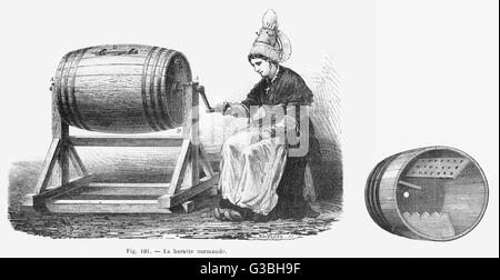 A Normandy Butter churn in  action and in cross-section,  showing the shaped interior  paddles for working the butter - Stock Photo