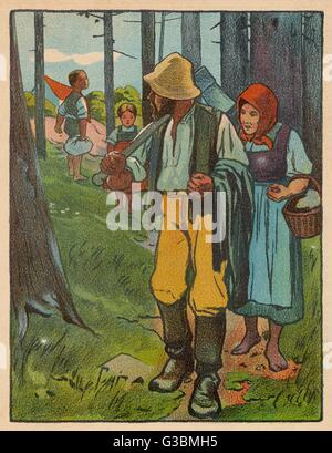 Hansel and Gretel with their parents in the wood. - Stock Photo