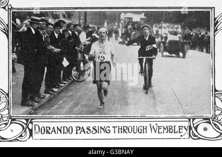 THE MARATHON Dorando Pietri passing through Wembley. He finished first but  was disqualified because he  was helped - Stock Photo