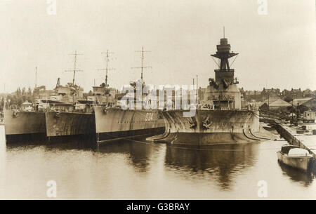 Ships in Chatham Dockyard, Kent.  They are the Monitor HMS Marshal Soult, the D34 Destroyer HMS Velox, and two V - Stock Photo