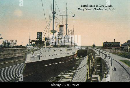 An American battleship in dry dock in the Navy Yard at Charleston, South Carolina, USA.      Date: circa 1908 - Stock Photo