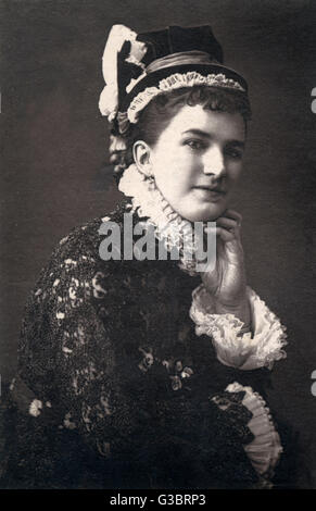 A Victorian woman in a hat and dress with frilly white ruff and cuffs, possibly an actress in theatrical costume. - Stock Photo