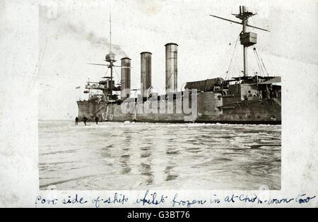 HMS Suffolk, British Monmouth class armoured cruiser, frozen in ice at Chin-Wang-Tao, China.      Date: circa 1908 - Stock Photo