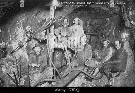 Miners at work  drilling one thousand feet underground in a gold mine at Victor  Alamy