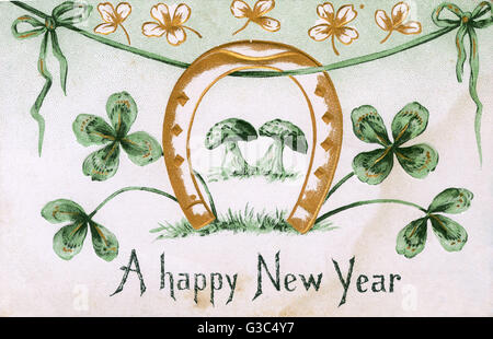 Irish New Year Souvenir postcard featuring a number of 'Good Luck' devices.     Date: circa 1906 - Stock Photo