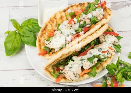 Two chicken souvlaki flatbread wrap sandwiches - Stock Photo