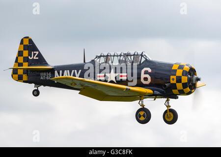 North American Aviation AT-6C Harvard (Texan, SNJ) training aircraft from the second world war G-TSIX - Stock Photo
