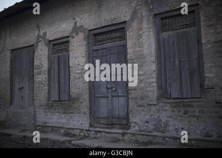 Old house with locked wooden door and window. Ujjain, Madhya Pradesh, India - Stock Photo