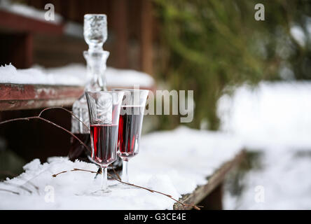 Decanter and wineglasses of red wine outdoors - Stock Photo