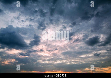 Dramatic sky with storm clouds as background - Stock Photo