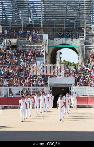 Razeteurs marching in the arena, Camargue race, amphitheatre of Arles, Arles, Provence-Alpes-Côte d'Azur, France, - Stock Photo