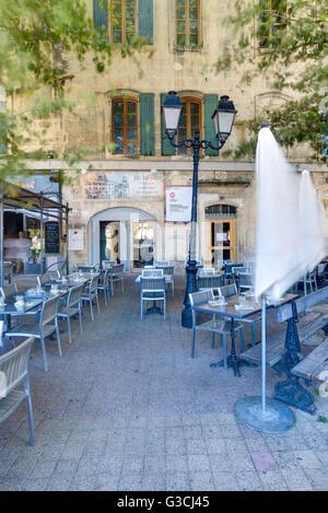 Restaurant, terrace, Librairie Actes Sud, Arles, Bouches-du-Rhone, Provence-Alpes-Cote d'Azur, Southern France, - Stock Photo