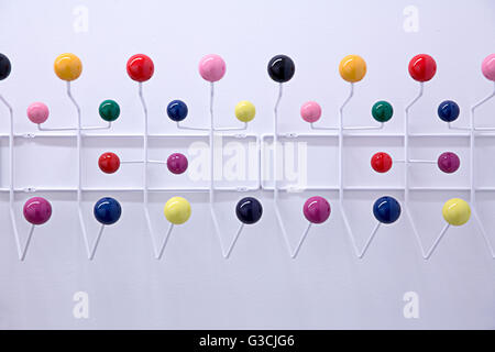White coatrack with colourful sphere hooks - Stock Photo