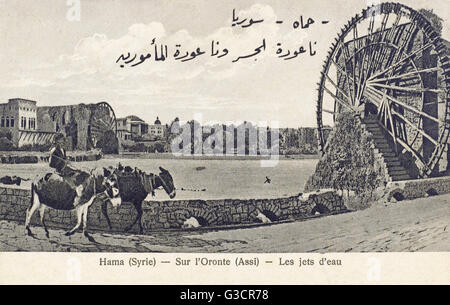 Hama, Syria - The Giant waterwheels on the Orontes River. The city is renowned for these seventeen 'norias', which - Stock Photo