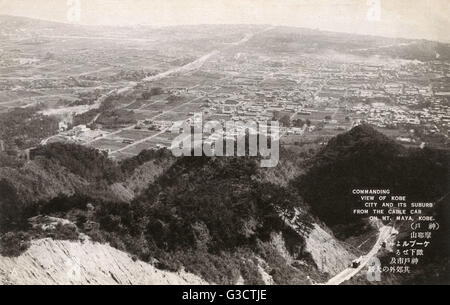 Kobe, Japan - Commanding view of the city and suburbs from the cable car on Mt Maya     Date: 1935 - Stock Photo