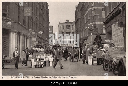 London Life: A Street Market in Soho, the Latin Quarter - Looking down Rupert Street toward Brewer Street     Date: - Stock Photo
