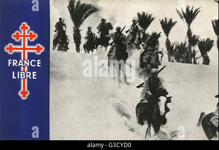 WW2 - Free French Spahis riding through the desert dunes - North Africa.     Date: circa 1943 - Stock Photo