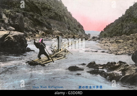 Japan - Poling rafts along the Hozu River - a part of Katsura River in Kyoto Prefecture, Japan     Date: circa 1910s - Stock Photo