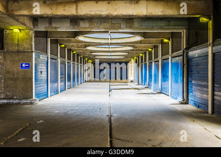 Industrial look pedestrian underpass in Golden Lane Estate, a 1950s council housing complex in the City of London. - Stock Photo