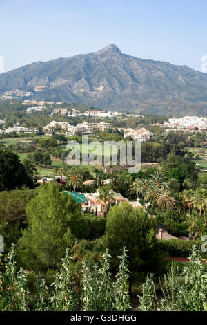 Overlooking golf courses of Marbella, with La Concha mountain in background, Marbella, Andalusia, Spain.
