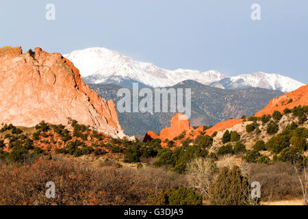 Sandstone spires and rock formations at the base of majestic Pikes Peak in the Garden of the Gods Park in Colorado - Stock Photo