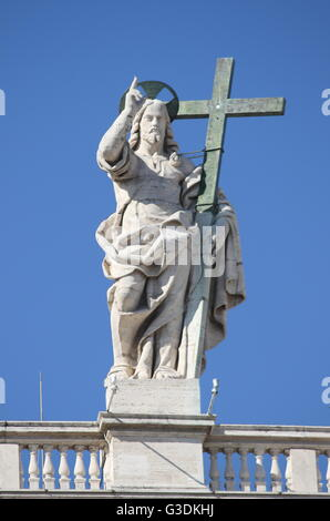 Statue of Jesus on the top of Saint Peter Basilica facade. Rome, Italy - Stock Photo