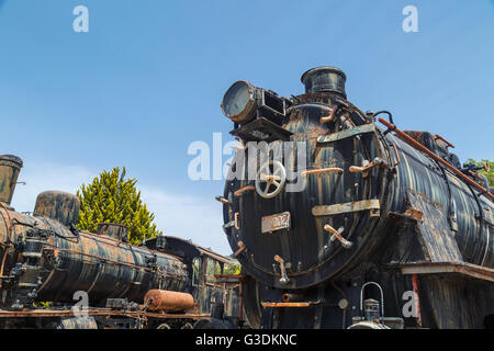 AYDIN, TURKEY - APRIL 30, 2016 : View of historical old iron train locomotives exhibited in Camlik Train Museum. - Stock Photo