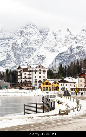 Belluno, Italy - December 14, 2014: hotels and restaurants at the Misurina lake during the winter season - Stock Photo